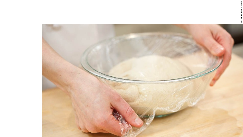 5. Lightly spray 2-quart bowl with vegetable oil spray; transfer dough to bowl and cover with plastic wrap. Let dough rise in warm, draft-free place until doubled in size, about 1 hour, then fold over itself several times and let rise for 30 more minutes. Then fold again and let rise for another 30 minutes.