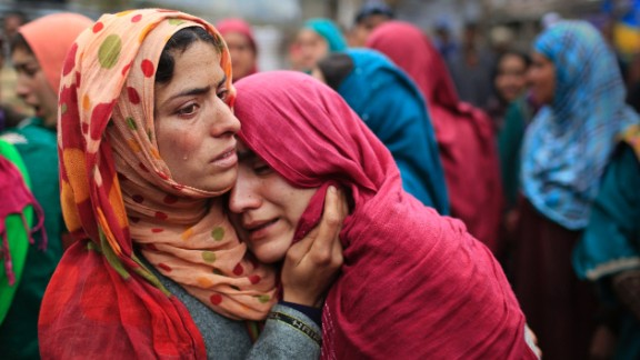 Unidentified relatives cry during the funeral procession of Zia-Ul-Haq in Hirpora on April 25.