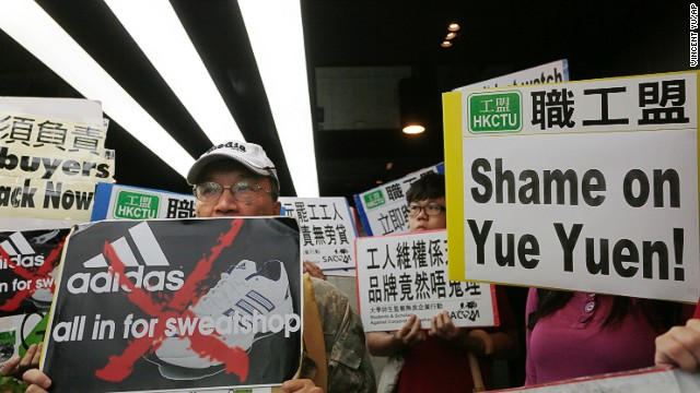 Labor activists protest in front of an Adidas office in a Hong Kong shopping mall.
