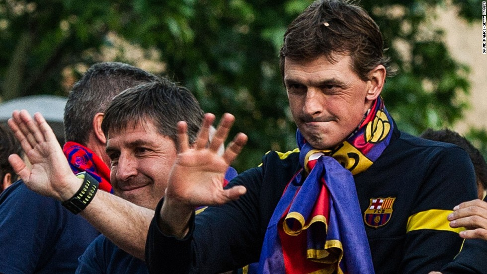 Vilanova and his assistant Jordi Roura celebrate as Barcelona win La Liga with a total of 100 points - the highest total in the club's history.