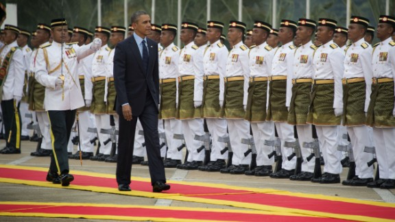 US President Barack Obama (C) inspects the Royal Malay Regiment Guard of Honour during his welcoming ceremony at parliament house in Kuala Lumpur on April 26, 2014. Obama arrived in Malaysia for a visit aimed at energising relations with the predominantly Muslim nation and re-focusing an Asian tour repeatedly distracted by foreign-policy crises elsewhere. AFP PHOTO / Jim WATSON (Photo credit should read JIM WATSON/AFP/Getty Images)