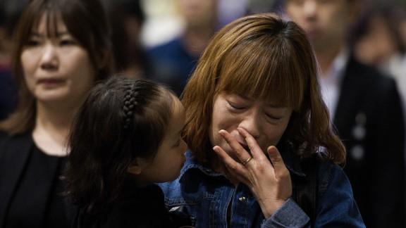 People in Ansan attend a memorial for the victims on April 26.