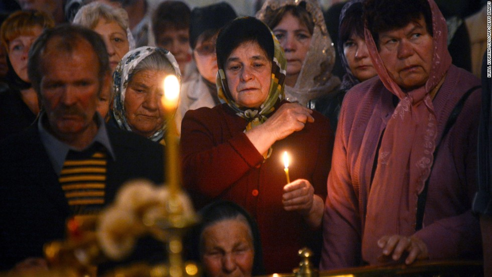Relatives and friends of a man killed in a gunfight participate in his funeral ceremony in Slovyansk on Saturday, April 26.