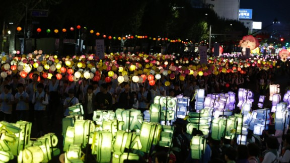 South Korean Buddhists carry lanterns in a parade in Seoul on Saturday, April 26, to honor the memory of the dead and the safe return of the missing.