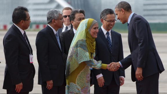 Obama is greeted by Malaysian officials as he deplanes from Air Force One at the Royal Malaysian Air Force Airbase outside of Kuala Lumpur on Saturday, April 26.