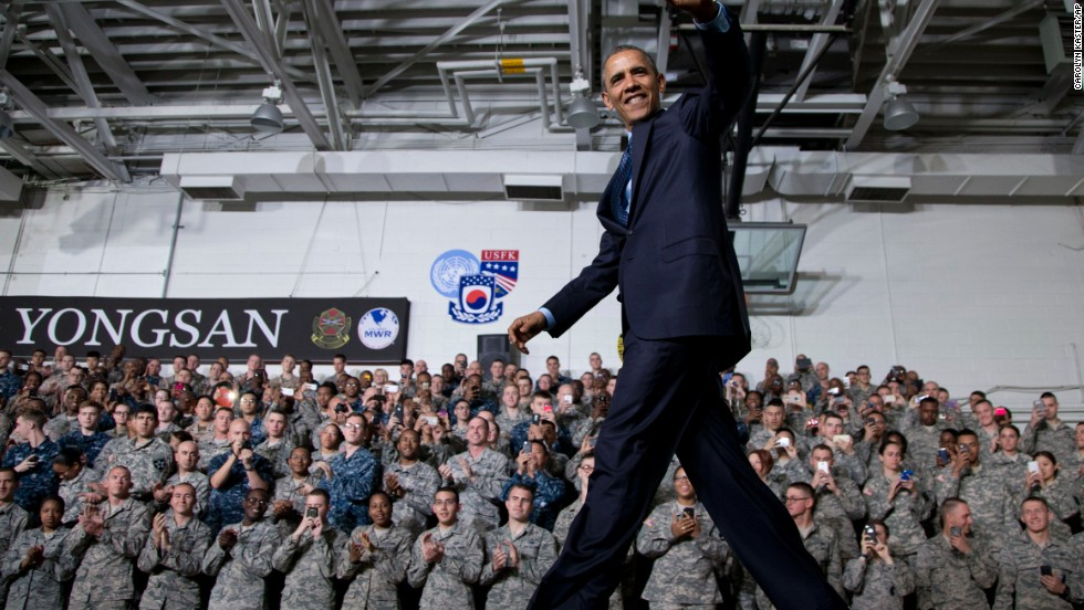 Obama waves to the crowd as he arrives to speak in the Collier Field House at U.S. Army Garrison Yongsan in Seoul, South Korea, on April 26.