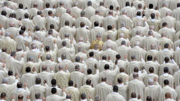 Priests attend the canonization Mass for Popes John XXIII and John Paul II at the Vatican on April 27.