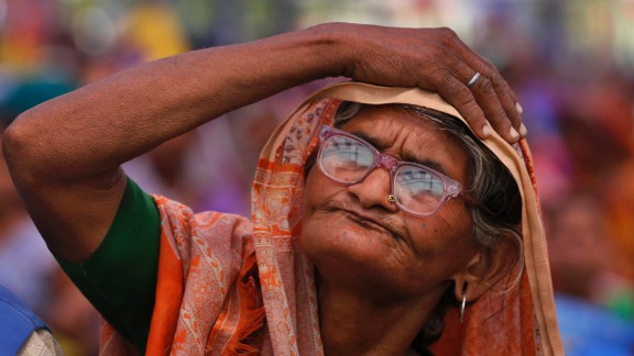 A supporter listens to Bahujan Samaj Party leader Mayawati during an election rally in Allahabad on Sunday, April 27.
