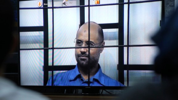 The second son of former Libyan leader Moammar Gadhafi appeared via a video link at his trial at a court in Tripoli.