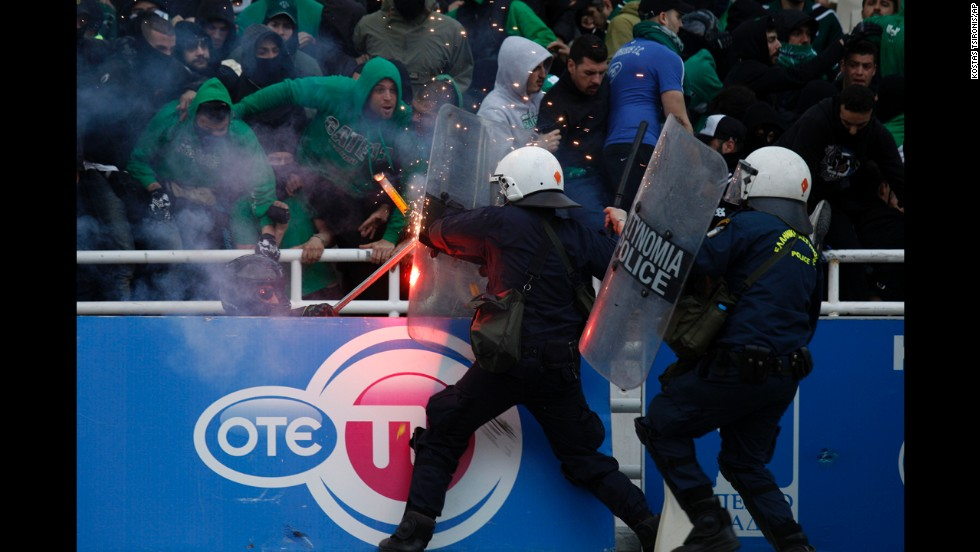 Riot police clash with soccer fans at the Olympic Stadium in Athens, Greece, prior to the Greek Cup final between Panathinaikos and PAOK on Saturday, April 26. Panathinaikos won the game 4-1.
