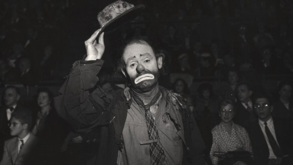 """American circus performer Emmett Kelly Sr. lifts his hat at the circus in 1943. His character Weary Willie, a sad and tattered tramp, is one of the best-known clowns of the Ringling Bros. and Barnum & Bailey combined circus. He joined the Ringling Bros. circus in 1942 and stayed with it until the late 1950s. In 1952, he made his motion-picture debut in """"The Greatest Show on Earth"""" with Charlton Heston and James Stewart."""