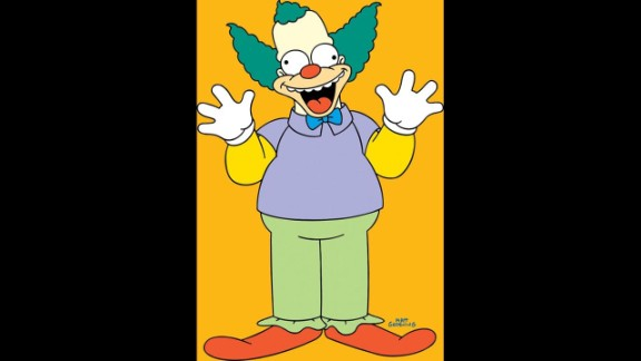 """Everybody knows the lovable, corrupt cartoon character Krusty the Clown from """"The Simpsons."""" He is host of his own """"The Krusty the Clown Show"""" and owner of his own fast food chain, Krusty Burger, known for its variety of animal meat burgers."""