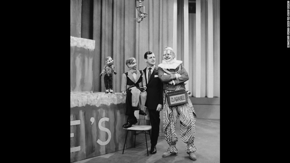 "Lew Anderson, right, as Clarabell the Clown from ""The Howdy Doody Show"" with Howdy Doody, Jerry Mahoney (dummy) and Paul Winchell. Clarabell was a mute clown who broke his silence in the show's final episode. With trembling lips and a visible tear in his eye, he spoke the show's final words: ""Goodbye, kids."" The show ran on NBC from 1947 to 1960."