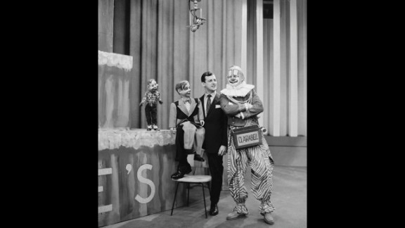"""Lew Anderson, right, as Clarabell the Clown from """"The Howdy Doody Show"""" with Howdy Doody, Jerry Mahoney (dummy) and Paul Winchell. Clarabell was a mute clown who broke his silence in the show's final episode. With trembling lips and a visible tear in his eye, he spoke the show's final words: """"Goodbye, kids."""" The show ran on NBC from 1947 to 1960."""