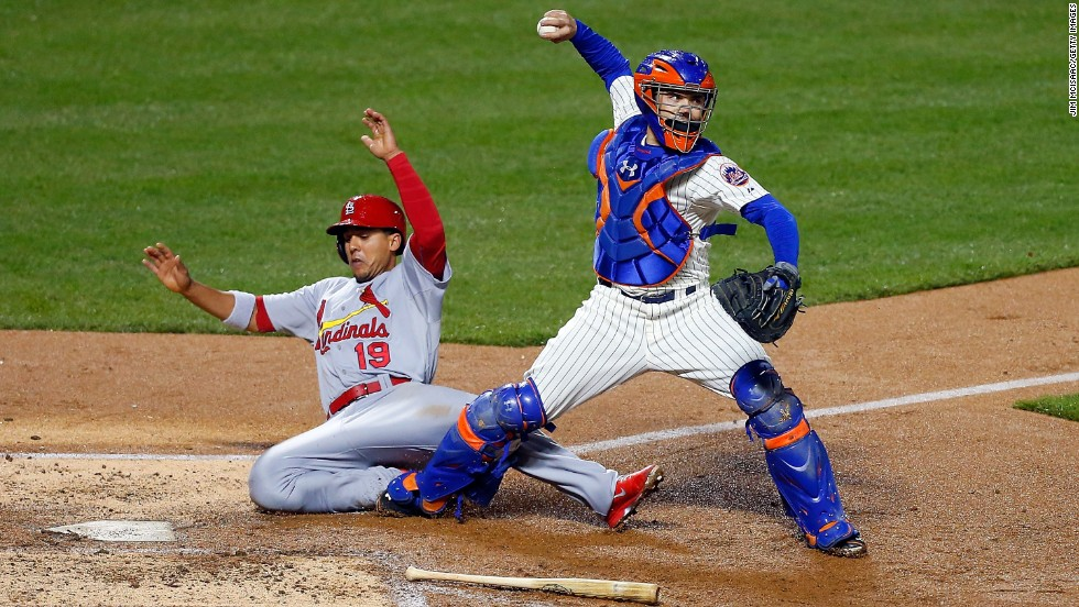 Jon Jay of the St. Louis Cardinals slides into Travis d'Arnaud of the New York Mets as d'Arnoud attempts a double play Tuesday, April 22, in New York. The Cardinals won the game 3-0.