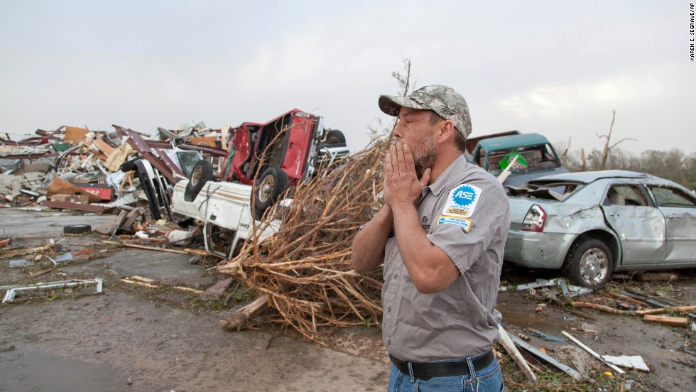 John Smith reacts after seeing what's left of his auto repair shop in Mayflower, Arkansas, on April 28.