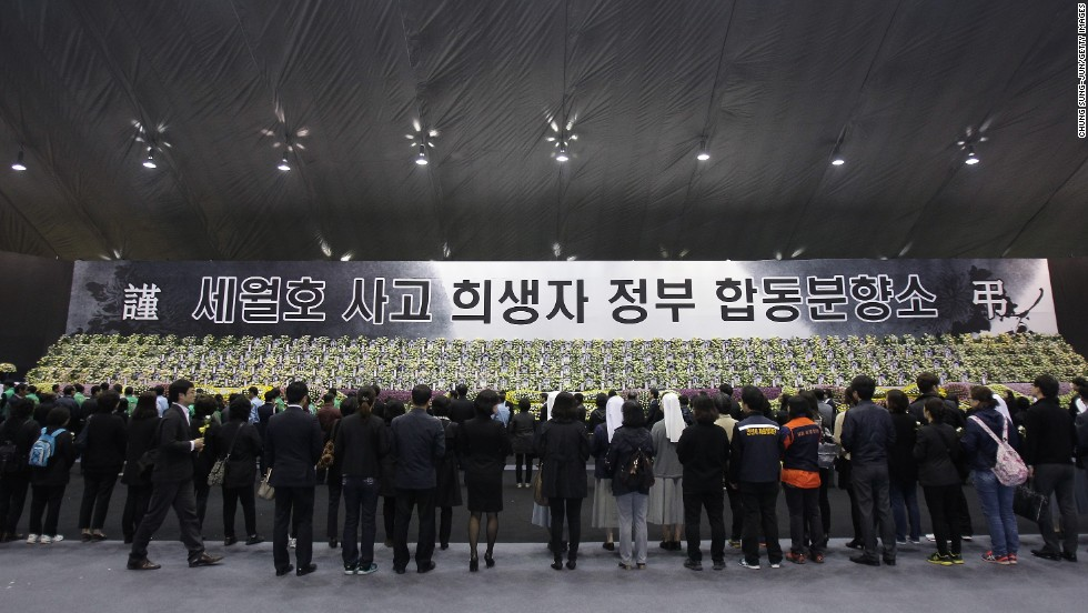 People pay tribute to victims at a memorial altar in Ansan, South Korea, on Tuesday, April 29.
