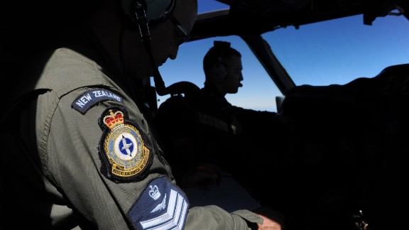 Pilot and aircraft captain, Flight Lieutenant Timothy McAlevey (R), with flight engineer Chris Poole (L), of the Royal New Zealand Airforce (RNZAF) P-3K2-Orion aircraft, flies his plane during the search for missing Malaysia Airlines flight MH370 in flight over the Indian Ocean on April 13, 2014 off the coast of Perth, Australia.