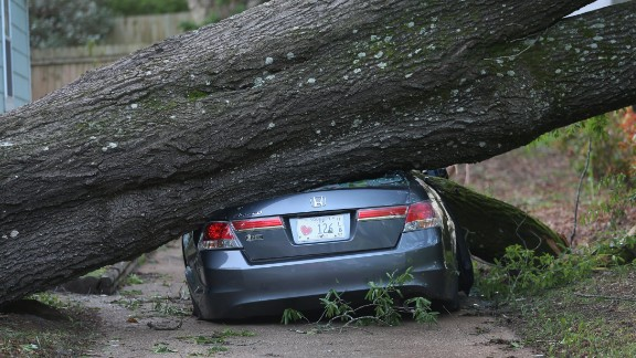 A large tree smashes a car in Tupelo, Mississippi, on April 30.
