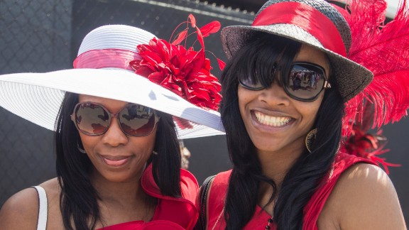 "Big glasses, big hats and big smiles. The derby is also referred to as ""The Run for the Roses"" for the garland of 554 red roses draped over the winner."