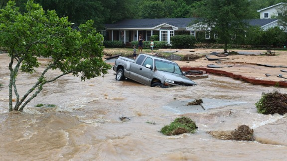 A truck is stuck in the middle of a flooded street after heavy rains in Pensacola on April 30.