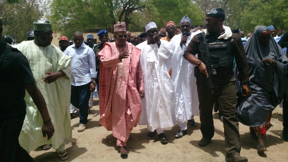 Borno state Gov. Kashim Shettima, center, visits the girls
