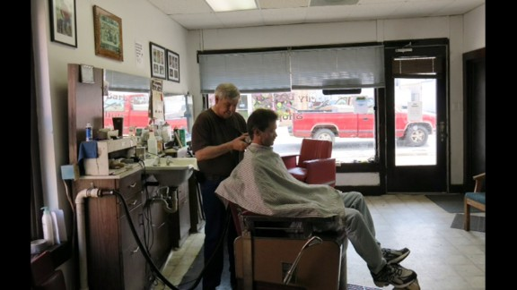 """George Robinson has clipped hair in Lake City for 43 years. He's for the project """"if it materializes like it's supposed to."""""""