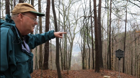 """Barry Thacker overlooks Lake City from Militia Hill. """"You embrace your heritage. You don't run away from it."""""""
