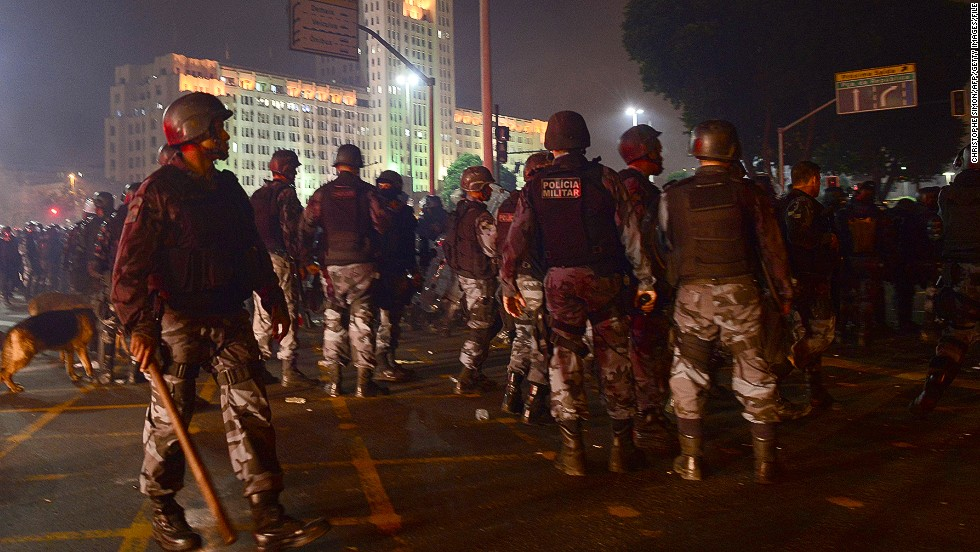 Police prepare for a long night of clashes with protesters.