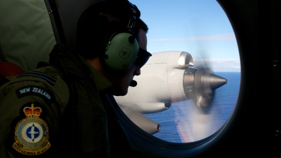 :FLTLT Jamin Baker, a crew member of a Royal New Zealand Air Force P-3 Orion on lookout whilst taking part in the search trying to locate missing Malaysia Airways Flight MH370 over the southern Indian Ocean on April 11, 2014.