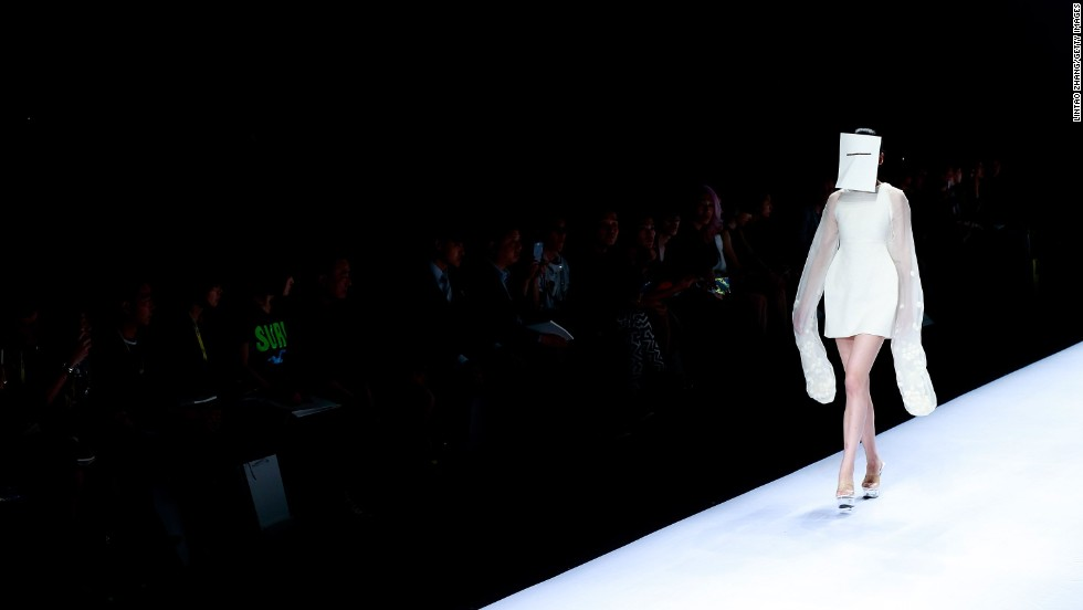 A model walks a runway in Beijing on Saturday, April 26, during China Graduate Fashion Week. She is wearing designs from the Hubei Institute of Fine Arts Graduate Show.