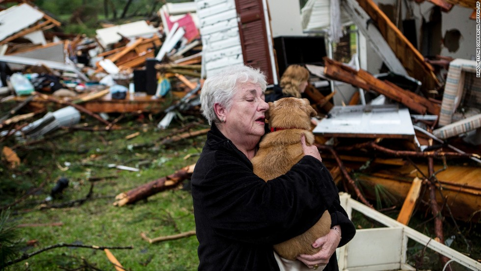 "Constance Lambert embraces her dog after finding it when she returned to her tornado-ravaged home in Tupelo, Mississippi, on Monday, April 28. A <a href=""http://www.cnn.com/2014/04/27/us/gallery/central-u-s-storms-tornadoes/index.html"">powerful storm system</a>, including a series of tornadoes, claimed at least three dozen lives in several states."