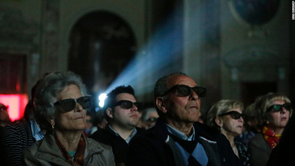 People wear 3-D glasses at a parish church near Bergamo, Italy, as they watch a screening of the canonization of Pope John XXIII and Pope John Paul II on Sunday, April 27. Pope Francis declared the two men saints before hundreds of thousands of people at the Vatican.