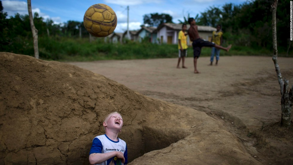 "Maicon de Jesus Dias recovers a ball from an open grave during a soccer game with friends at a cemetery in Una, Brazil, on Tuesday, April 29. <a href=""http://www.cnn.com/2014/04/25/world/gallery/week-in-photos-0424/index.html"">See last week in 30 photos</a>"