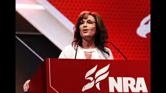 "In this photo, taken from the National Rifle Association's blog, Sarah Palin addressed the crowd on Saturday, April 26, saying, ""if you control arms, you control the people."""