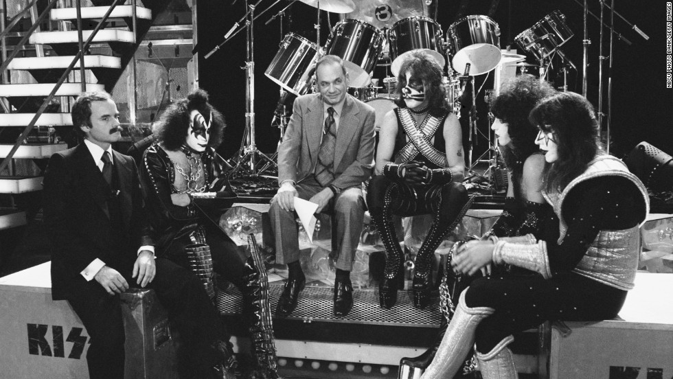 "KISS' trip to the top was guided by manager Bill Aucoin, left, who sat down with the band for an NBC documentary, ""Land of Hype & Glory,"" that aired in 1978. At center, with Peter Criss, is NBC's Edwin Newman."