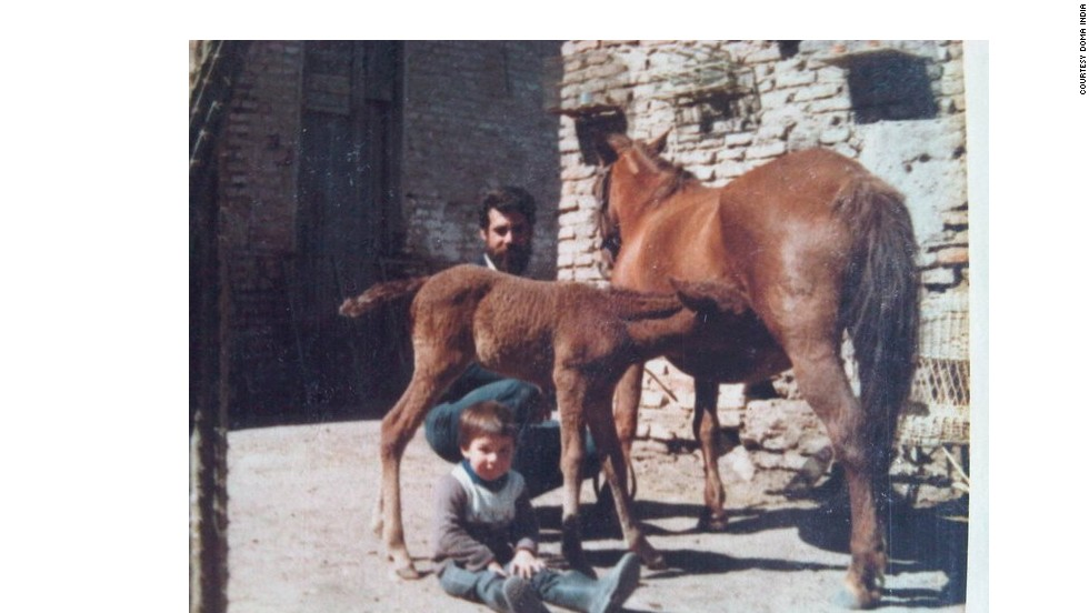 The school was founded by the Scarpati family. Here a young Cristobal and his father Oscar tend to two horses.