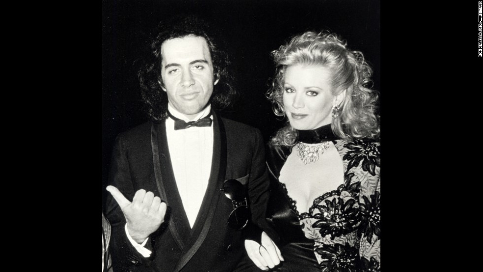 "Simmons has been with former Playboy Playmate Shannon Tweed since 1983. The two married in 2011 and co-starred in the reality show ""Gene Simmons Family Jewels."" Here, the two attend the Oscars in 1985."