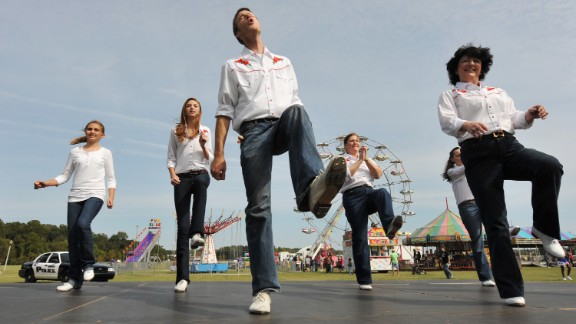 """""""Rocky Top"""" has become ingrained among thousands of Tennesseans, from the Smoky Mountains in the east to the western bluffs along the Mississippi River. Kelly Lovelace, 24, center, kicks it to the tune of """"Rocky Top"""" with the Riverboat Cloggers during the 2012 Bartlett Festival and Car Show."""
