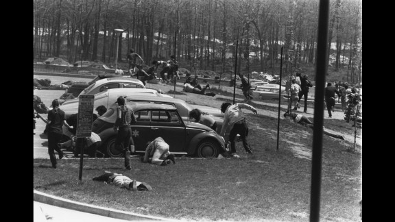 Students run for cover after the National Guard opens fire. Twenty-eight guardsmen fired into the crowd for 13 seconds, wounding nine students and killing 4.