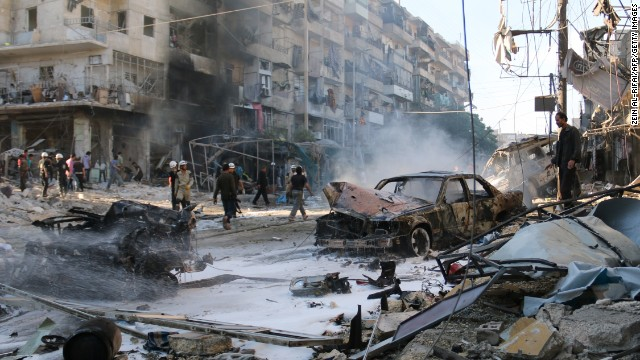Syrians gather at the site of reported air strikes by government forces in the Halak neighbourhood in northeastern Aleppo, on May 1. According to the Syrian Observatory for Human Rights, at least 33 civilians were killed in the attack.