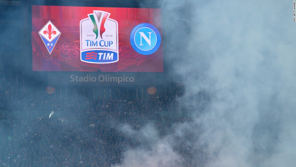 Smoke rises over Rome's Olympic Stadium before the Italian Cup Final. Napoli's ultras pelted the pitch with flares when news of the violence spread.