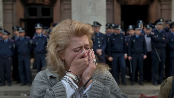 A woman cries in front of the burned trade union building in Odessa on May 3.