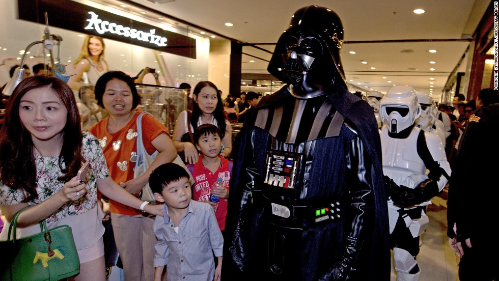 "A member of the ""Star Wars"" fan club in Thailand, dressed as Darth Vader, parades with others to celebrate ""Star Wars Day"" at a shopping mall in Bangkok."