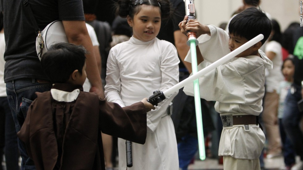 "Children wearing ""Star Wars"" costumes play with their light sabers inside a mall in Pasay City, Philippines."