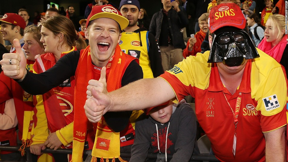 A Gold Coast Suns fan with a Darth Vader mask celebrates the team's win during the round seven Australian Football League match against the North Melbourne Kangaroos at Etihad Stadium in Melbourne.