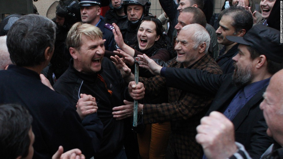 Pro-Russian militants who were arrested during a Ukrainian unity rally are greeted on Sunday, May 4, after being freed by police in Odessa. The men released Sunday had been detained after bloody clashes in Odessa, which ended in a deadly blaze. Forty-six people were killed in the bloodshed.