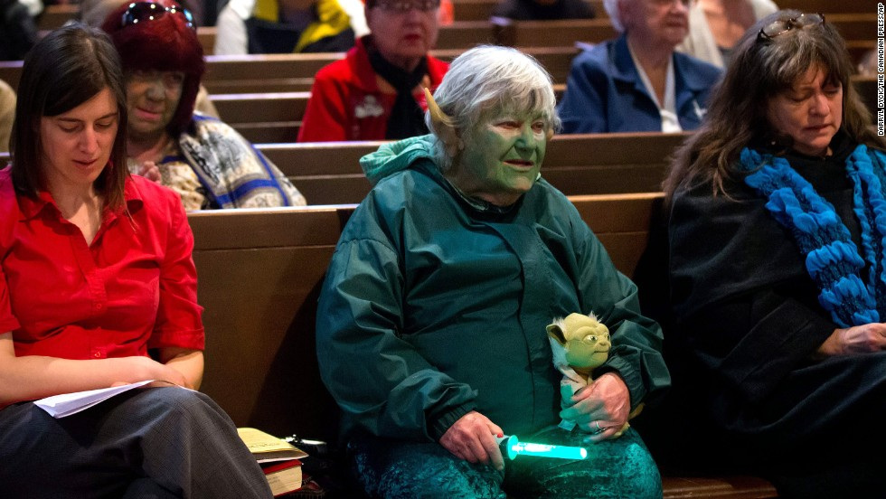"Freeda Elliott, 78, dresses as the ""Star Wars"" character Yoda while attending a ""Star Wars""-themed church service at St. Andrew's-Wesley United Church in Vancouver, British Columbia."