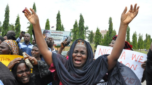 "An unidentified mother cries out during a demonstration with others who have daughters among the kidnapped school girls of government secondary school Chibok, Tuesday April 29, 2014, in Abuja, Nigeria.  Two weeks after Islamic extremists stormed a remote boarding school in northeast Nigeria, more than 200 girls and young women remain missing despite a ""hot pursuit"" by security forces and desperate parents heading into a dangerous forest in search of their daughters. Some dozens have managed to escape their captors, jumping from the back of an open truck or escaping into the bush from a forest hideout, although the exact number of escapees is unclear. (AP Photo/ Gbemiga Olamikan)"