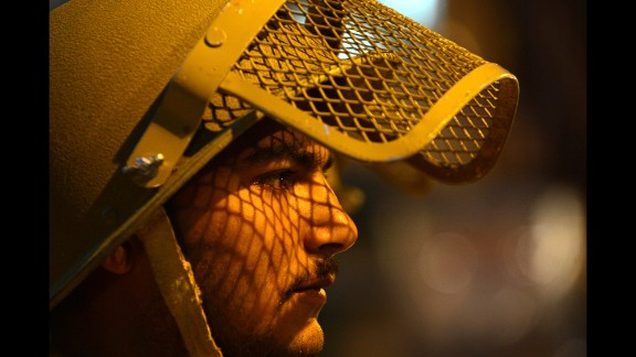 A police officer patrols during curfew in the Maisuma locality of Srinagar, India, on Friday, May 2.